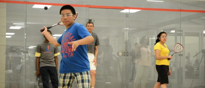 a youth plays squash